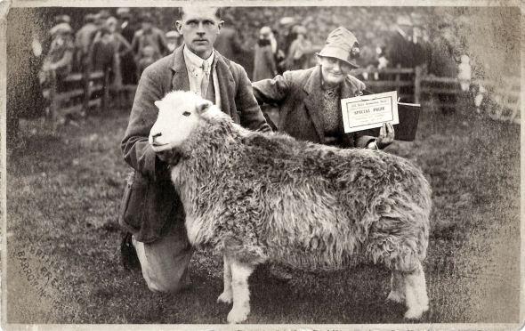 beatrix_potter Beatrix with her shepherd, Tom Storey and their prize-winning Herdwick ewe..jpg