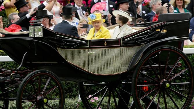Queen Elizabeth II arrives at the parade ring with Anne, Princess Royal